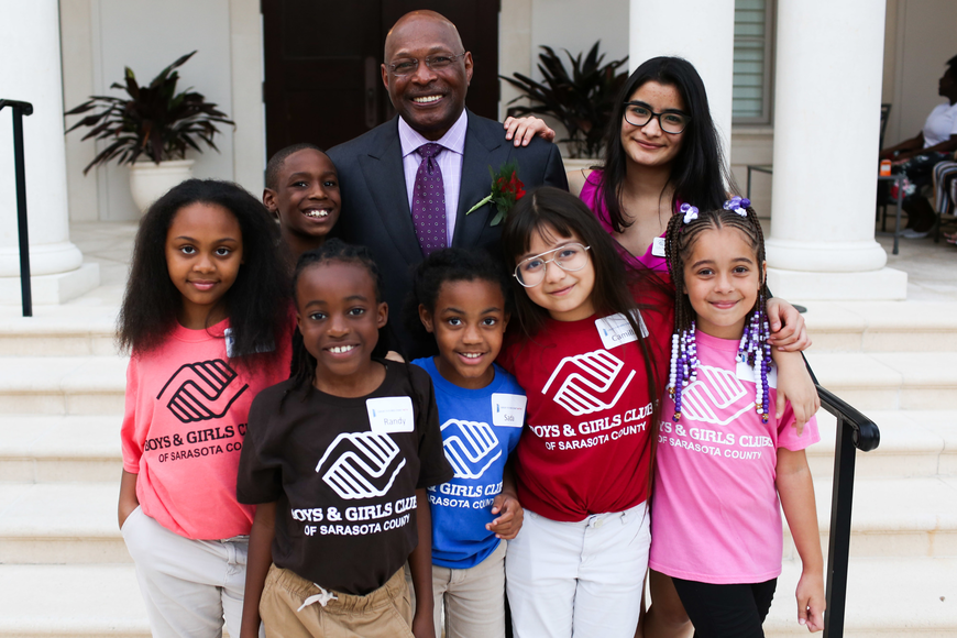 Archie Griffin with kids from the Boys and Girls Clubs of Sarasota County.