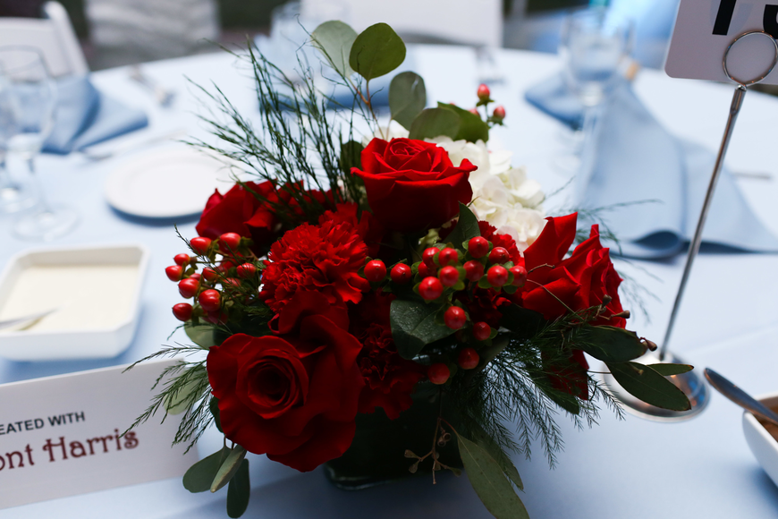 Red and white flowers adorned the baby blue tables.