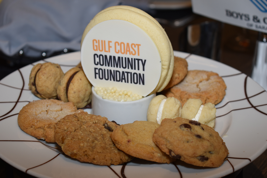 The Gulf Coast Community Foundation's logo was emblazoned onto cookies given out for dessert.