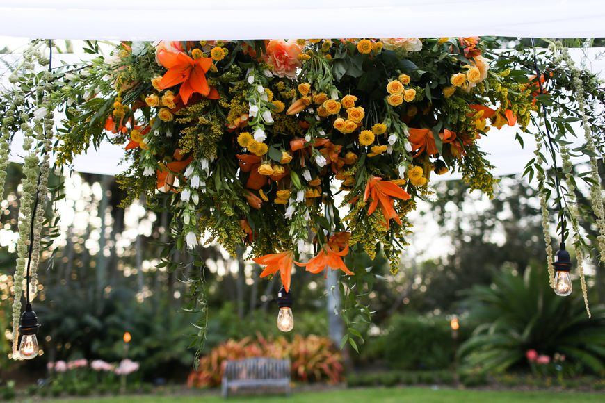 Floral arrangements hung above the table.