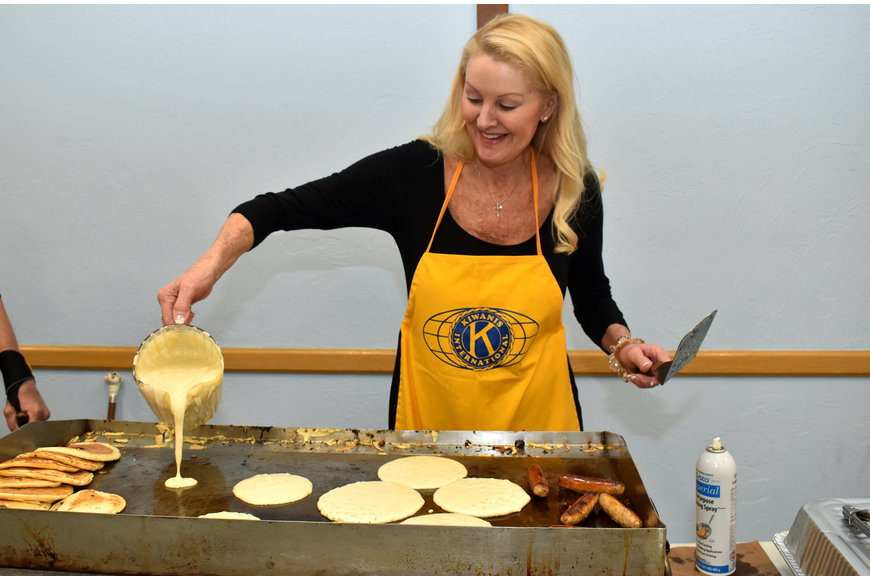 Susan Phillips is all smiles as she makes a batch of pancakes.