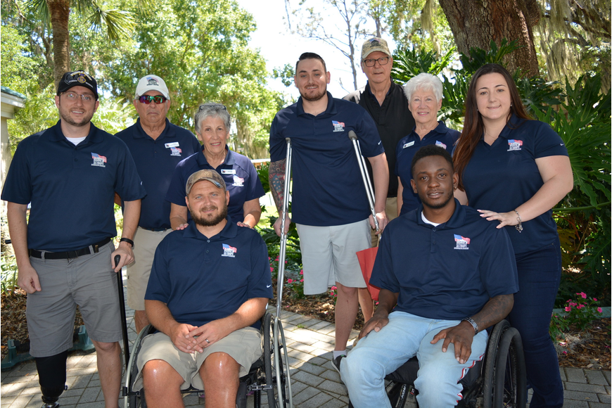 Clockwise from left: veteran Bobby Withers, Jim and Deb Kehoe, veteran Stephen Peterson, John and Kathi Skelton, Ashley Nickles, veteran Michael Monthervil and veteran Carl Moore.