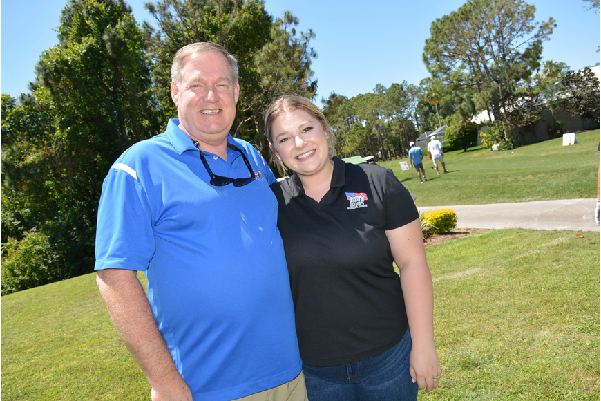Valrico's Tom Hier and his daughter Brittany Peterson volunteer at a hole. Peterson and her husband, Stephen, a veteran, will benefit from next year's golf tournament.