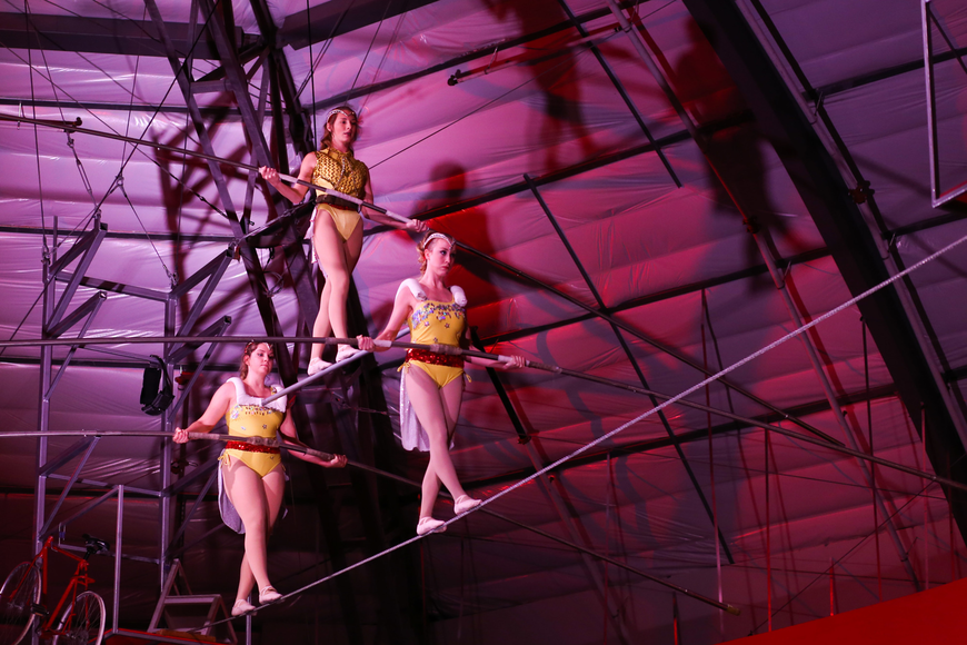 The performance rounded out with the high wire walkers.