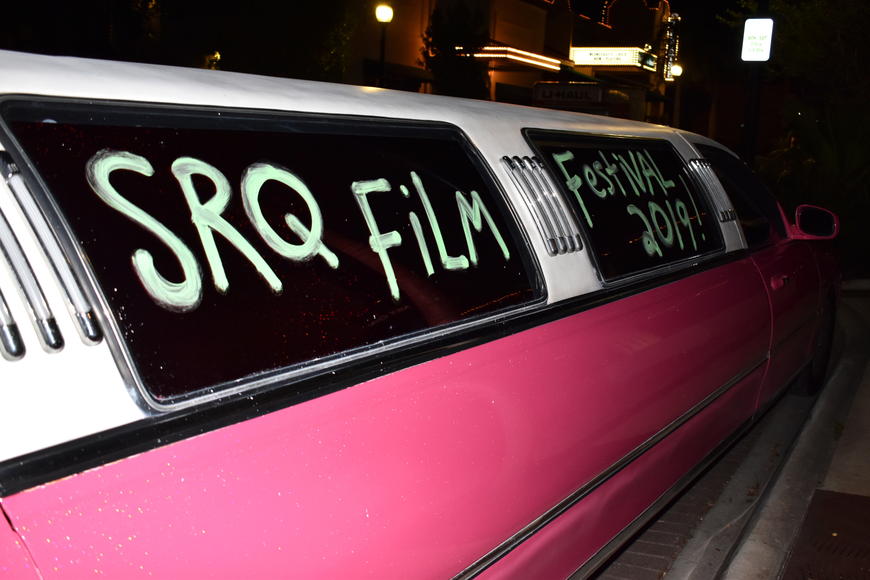 Eddie Ward parked his pink limo (for his business Eddie's Pink Limousine) outside the party.