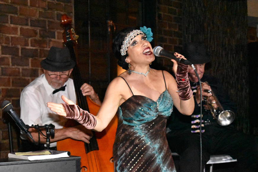 The Nancy Pastore Quartet performs for guests.