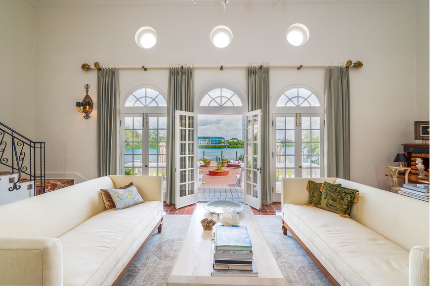 The living room features French doors that open onto the back patio.