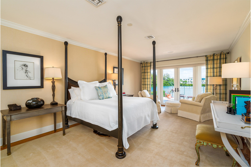 The master bedroom opens to a balcony that overlooks Sarasota Bay.