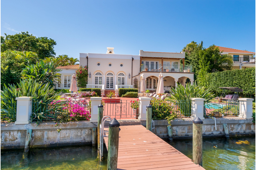 The home features a dock that connects to Sarasota Bay.