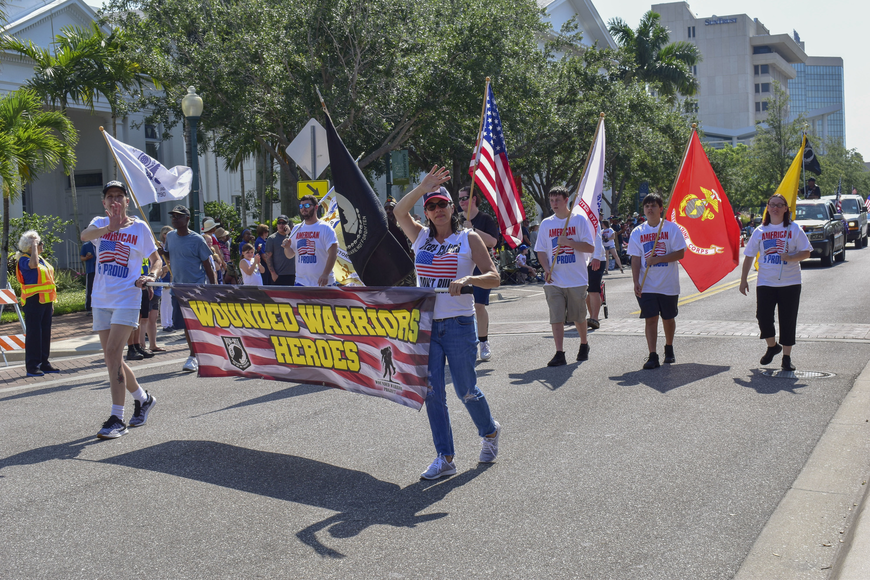 Members of Wounded Warrior Project march in the parade.