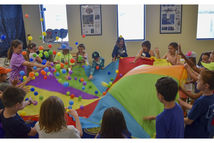 The Aqua Kids play a game that teaches them how a sedentary coral polyps gets its food.
