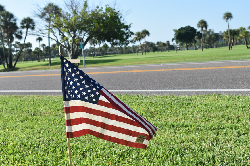 A flag flies along Gulf of Mexico Drive.
