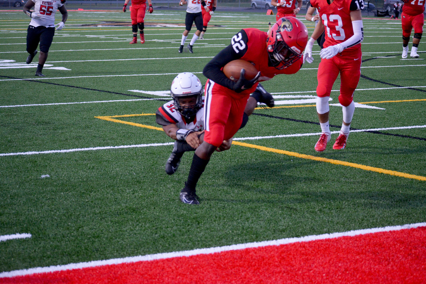 Freshman running back Lauriel Trotman dips into the end zone for a score.