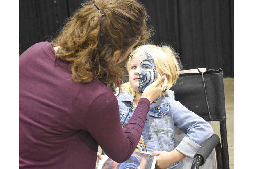Callie Smith, 6, gets her face painted.