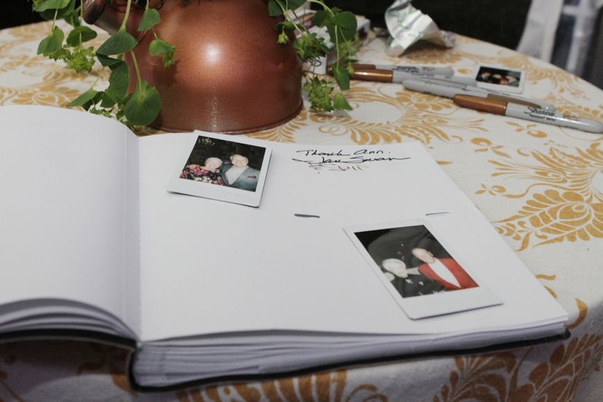 Guests took polaroid photos for a memory book.