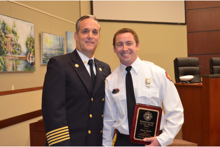 Fire Chief Paul Dezzi and 2019 Firefighter of the Year, Chase Opela.