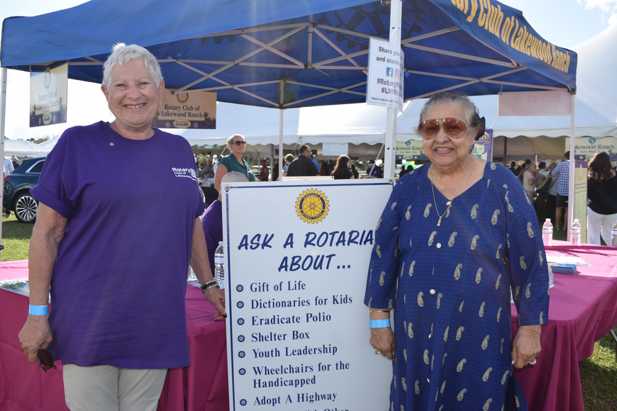 Joyce Borda, public information chair for the Rotary Club, talks to Mona Jain about becoming a member of the Rotary Club.