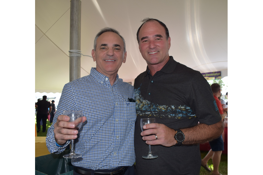 Lakewood Ranch residents Steve Sotir and Tom Wilwert have fun with friends during the Suncoast Food and Wine Fest.