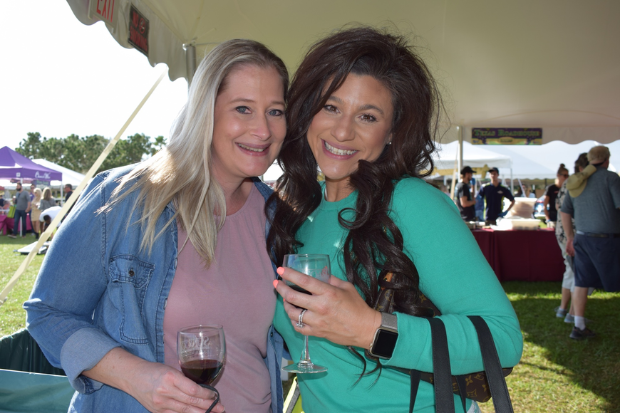 Parrish resident Jessica Zambello and Ellenton resident Elizabeth Henderson have a good time at their first Suncoast Food and Wine Fest.