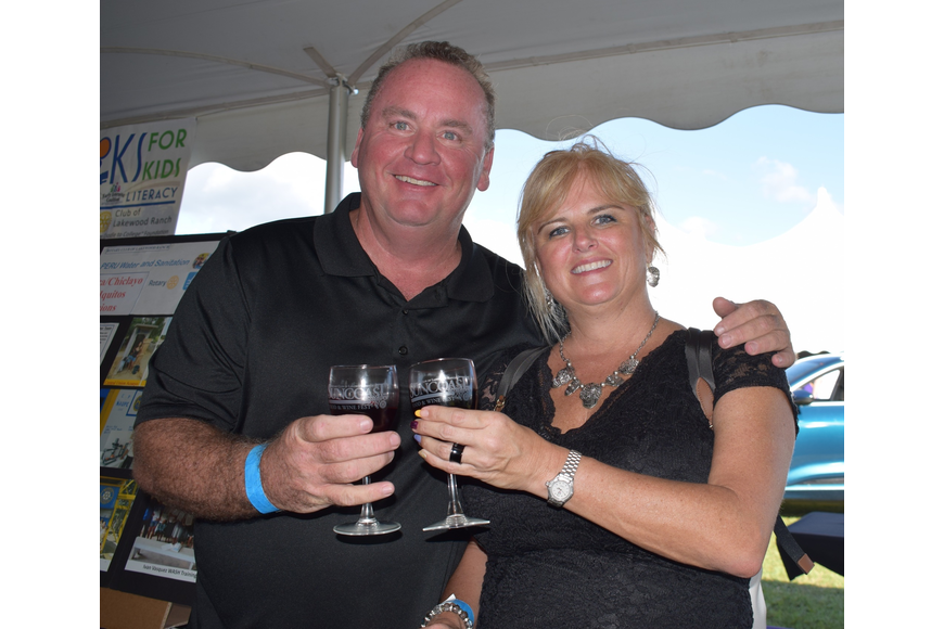 Chuck Swanson and Melissa Paukstis, both of Cape Coral, celebrate Paukstis' birthday at the Suncoast Food and Wine Fest.