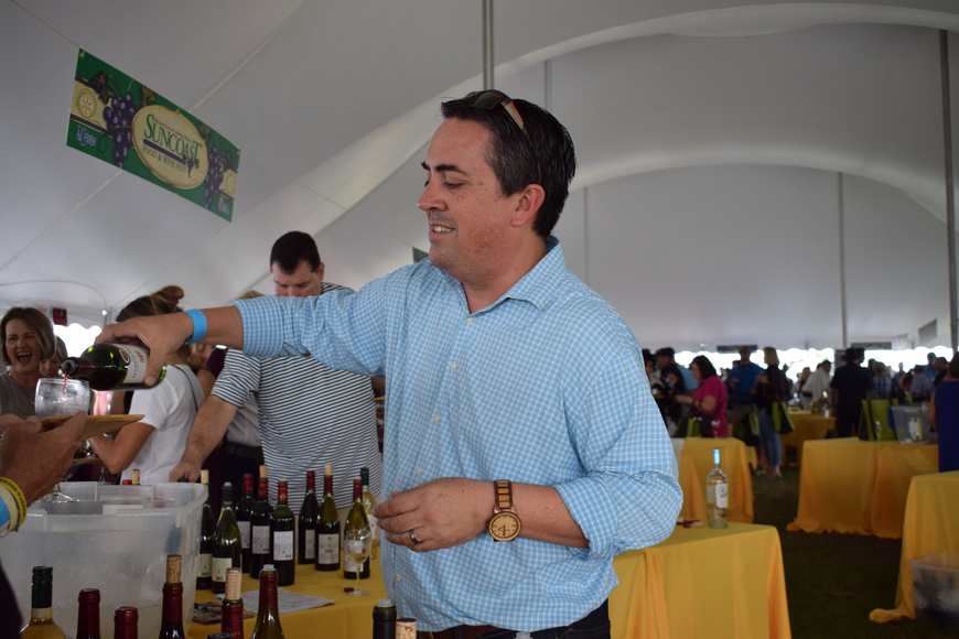 Zac Mendiola of Monsieur Touton Wines pours a glass during the annual Suncoast Food and Wine Fest.