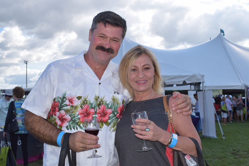 Lakewood Ranch resident Nino Simunovic and Largo resident Anna Rice enjoy the festival. Simunovic said the festival is a chance to find new restaurants and to try different wines.