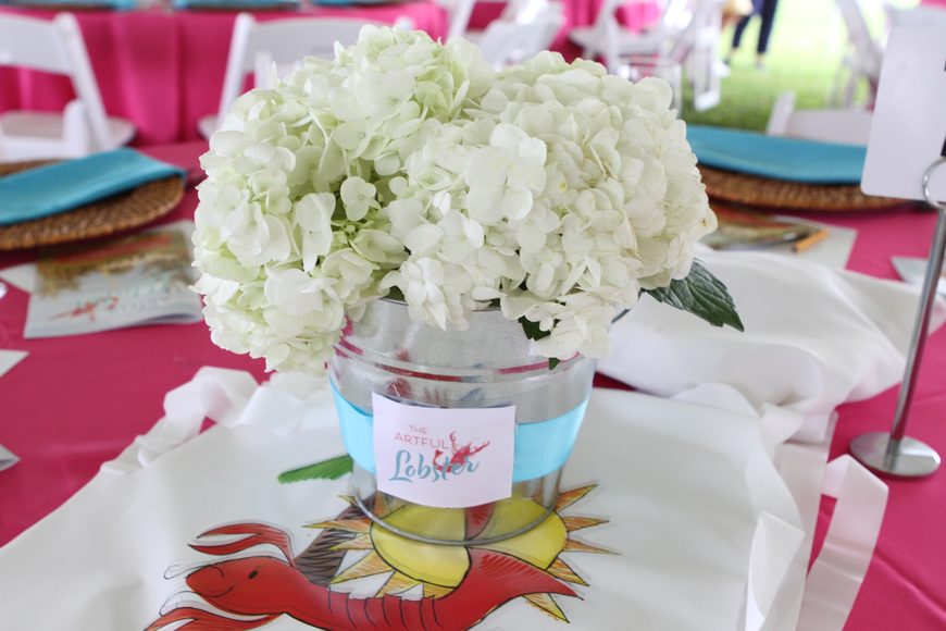 Each table had flowers and lobster bibs for guests.
