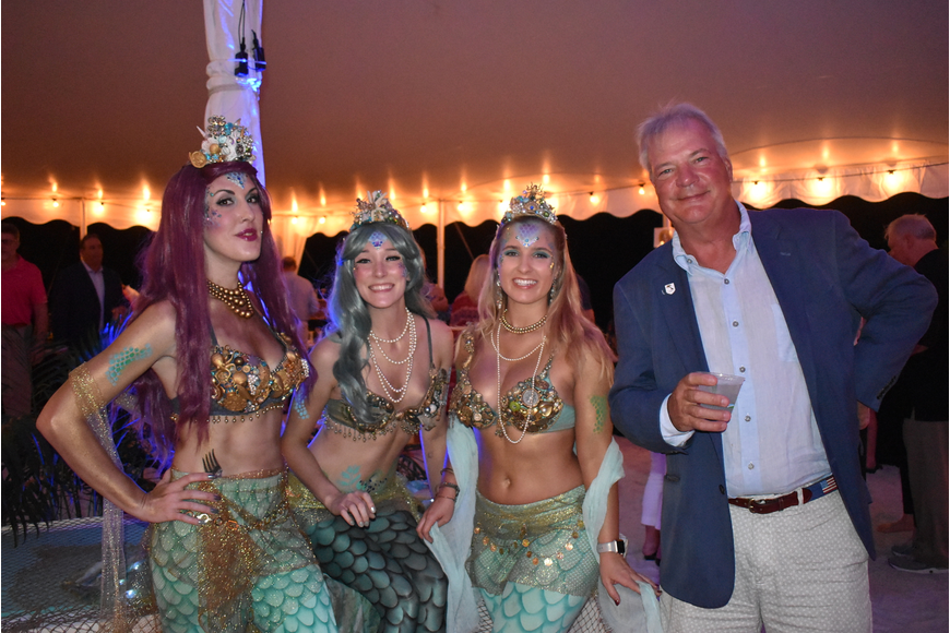 Mermaids Sarafina Murphy-Gibson, Hannah Bagnall and Rebecca Brillhart with Mark Wholzner.