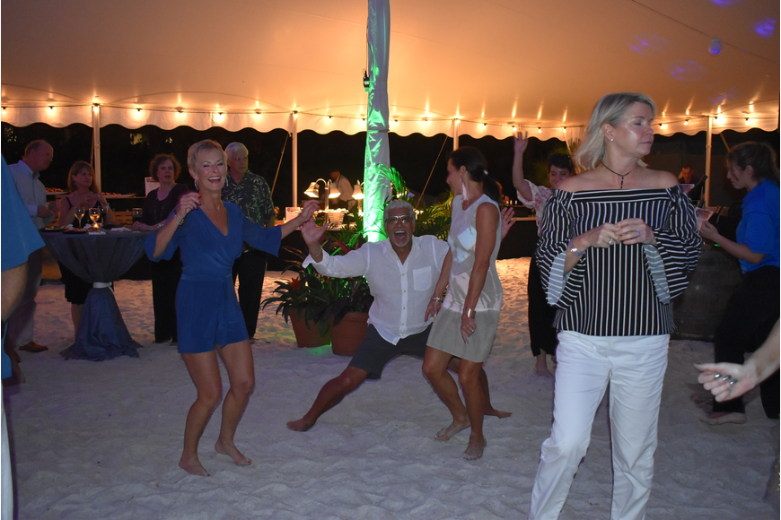The dancing heats up on the sand.