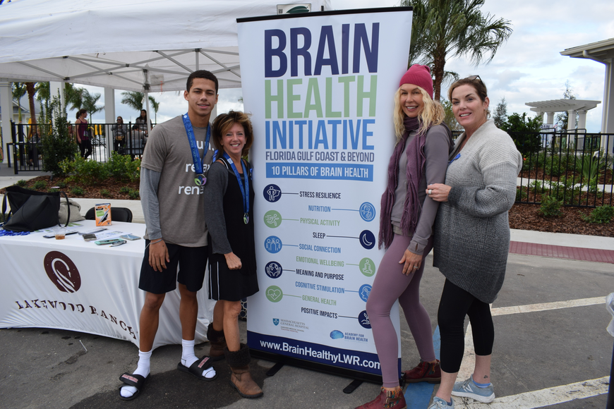 Hilton Hudson and his mom, Brain Health Initiative Executive Director Stephanie Peabody take a break with Trish Hart and Kim Miele.