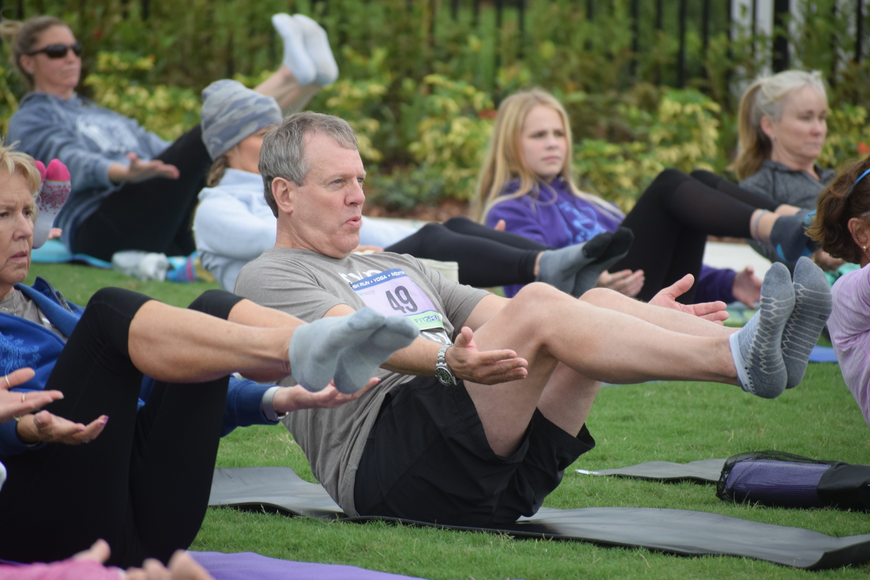 Lakewood Ranch's Mike Evers shows his yoga skills. Evers said he is really big into the brain fitness arena and he wanted to support the event.