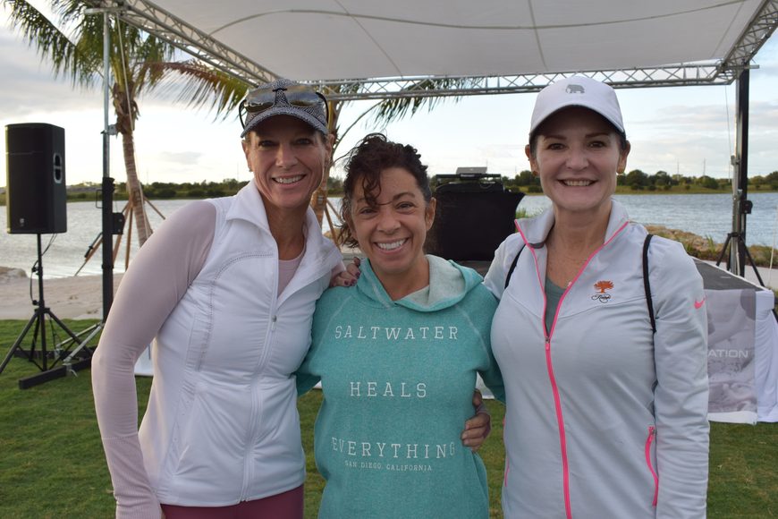 Lakewood Ranch's Christy Comito, Lisa DeFalco and Sonia Levy head toward the 5K start after picking their yoga spots.