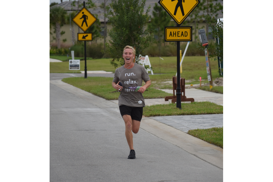 Tom Johnson, the marketing and leasing manager for Lakewood Ranch Commercial Realty, handles the final few yards of the race.
