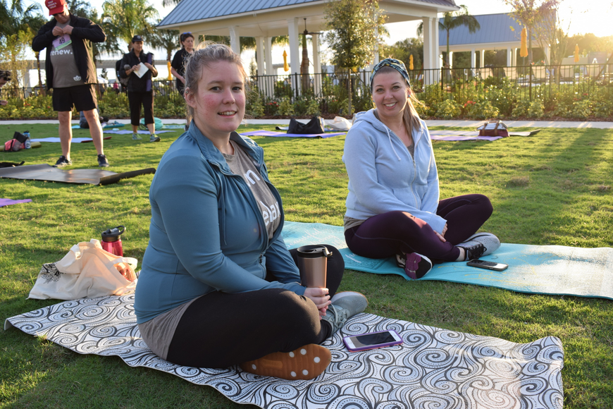 University Park's Sarah Dorsen and Sarasota's Brittany Lamb were two of the first entrants to pick a spot on the yoga lawn.