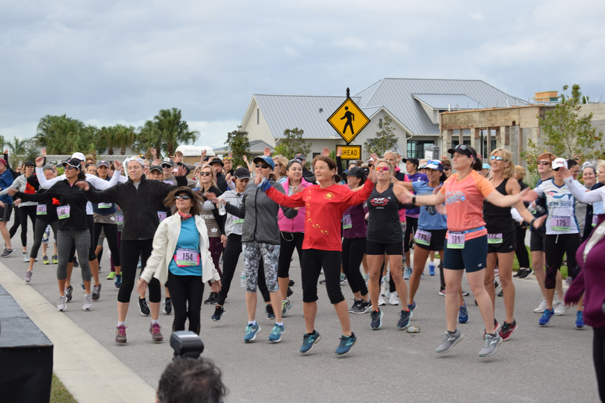 Approximately 250 runners warmed up for the 5K.