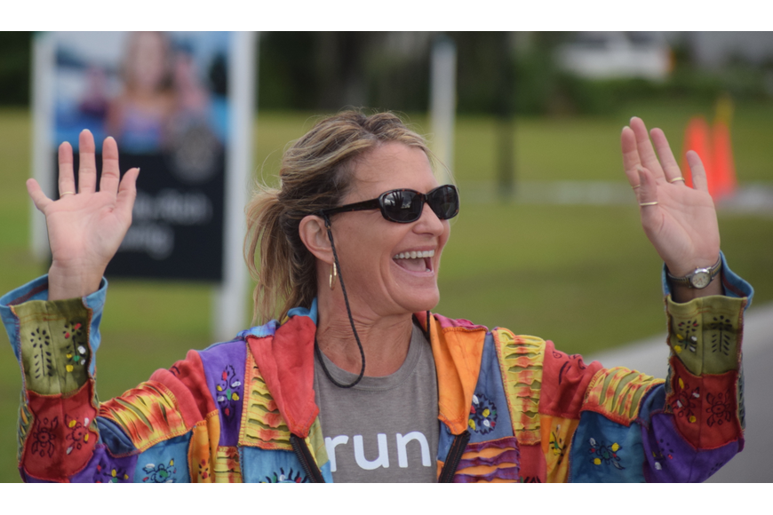 Jane Greene of Rotonda West celebrates her completion of the 5K. She said the event was a great experience and