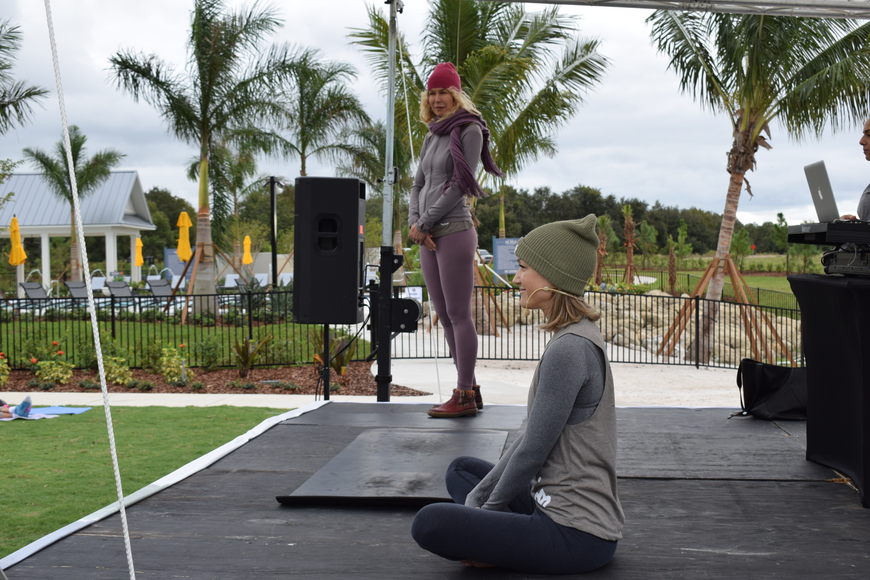 Boston's Trish Hart and Yoga Shack owner Courtney Smith led the meditation and yoga portions of the event.