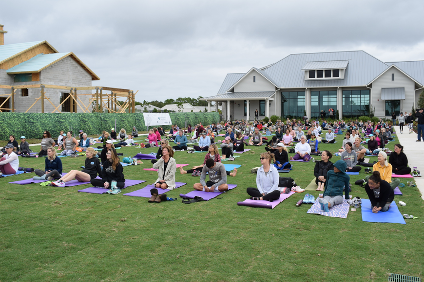 Entrants are ready for the yoga session to begin.