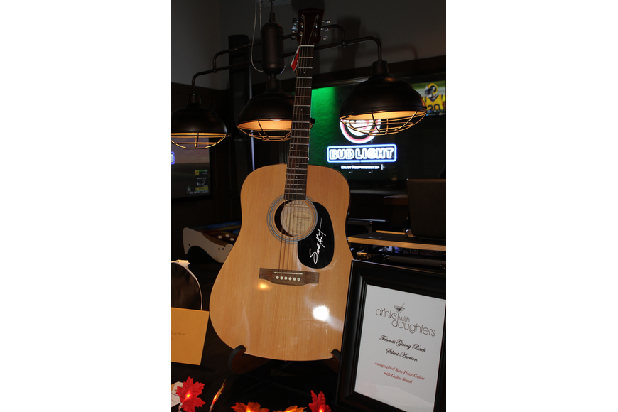 The night's raffle included a signed guitar and other prizes.