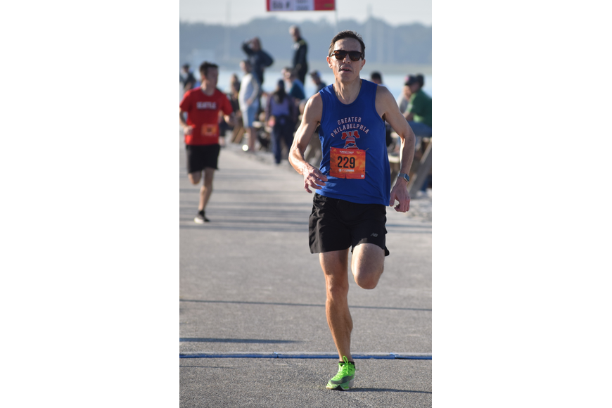 Mike Padilla of Phoenixville, Pa., finishes his victory in the Florida Turkey Trot 5K. He ran 16:37.