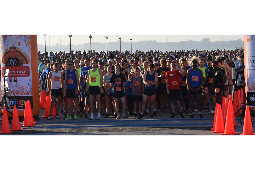 The 2,649 registered runners pack toward the start-finish line to begin the Florida Turkey Trot 5K.