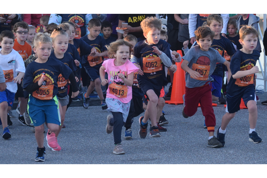 Children break away from the starting line in a kids dash.