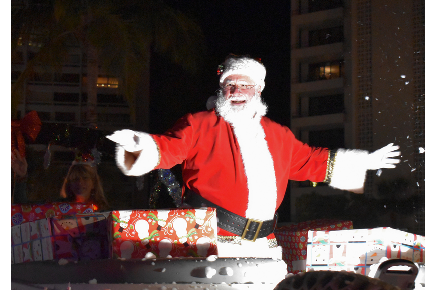 Santa Claus rounds out the parade.
