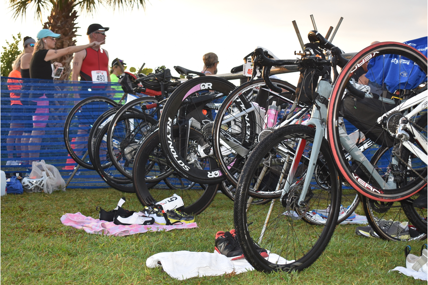 Bikes await riders in the transition area.