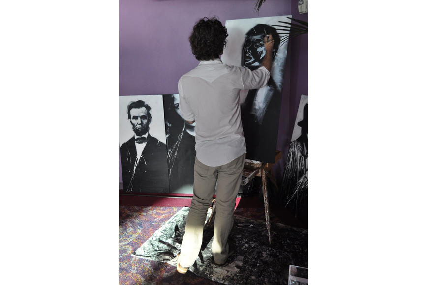 Tony Corbitt created black and white paintings of Sheryl Crow, Jim Henson and Audrey Hepburn during the gala.