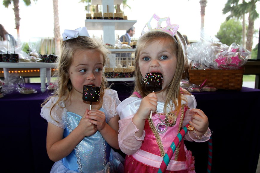 Avery Hunt, 3 ½, and Olivia Gambert, 3, have fun eating marshmallow treats before dinner.