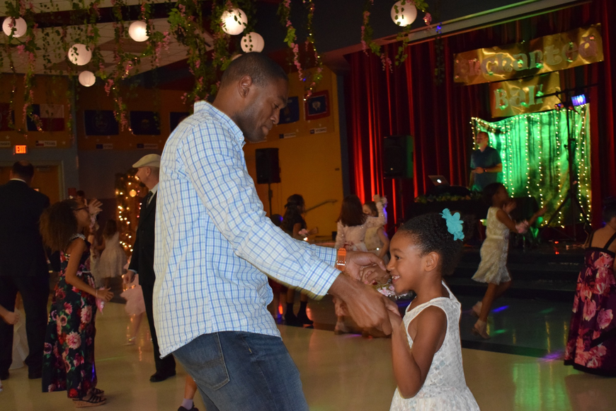 Kelvin Hearns dances with his daughter, Caydence, a kindergartner. Kelvin Hearns says his daughter was dancing before they even arrived at the father-daughter dance.