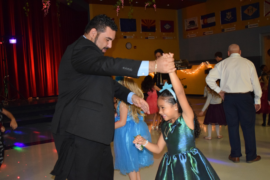 Luis Tejeda and his daughter Aryanna enjoy their first father-daughter dance.