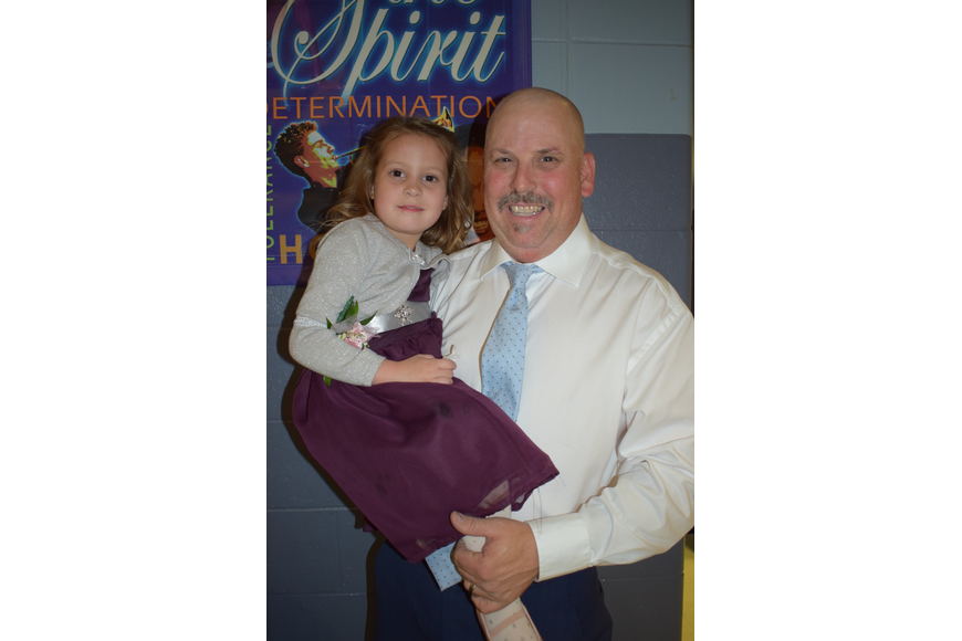 Macie Anderson, a pre-kindergartner, loves dancing with her dad, Kenny, during their first daddy-daughter dance.