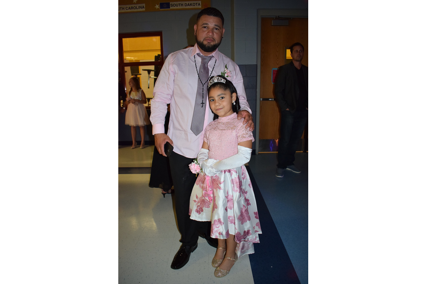 Sequiel Martinez and his daughter Jordice, a second grader, have fun at the dance. Jordice Martinez says the dance was good because she loves her dad.